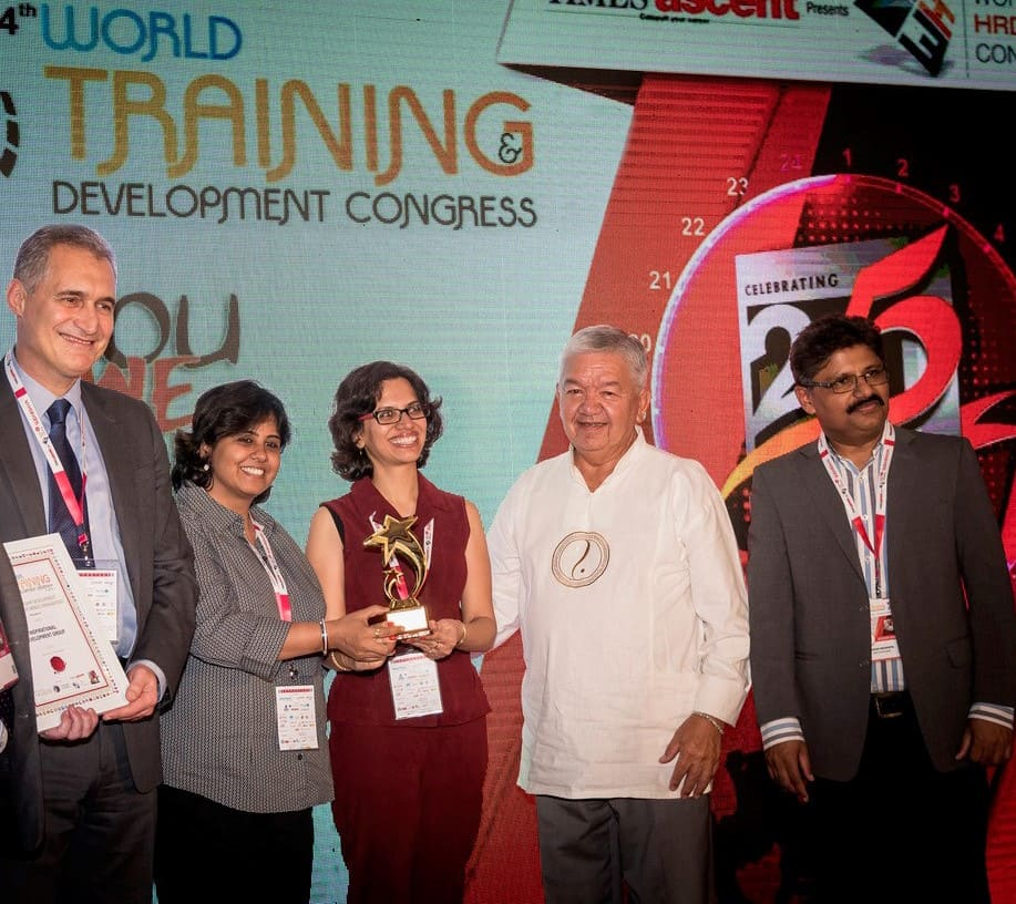From left, IDG's Craig Preston, Shilpa Duggal and Riya Arora accepting the award.