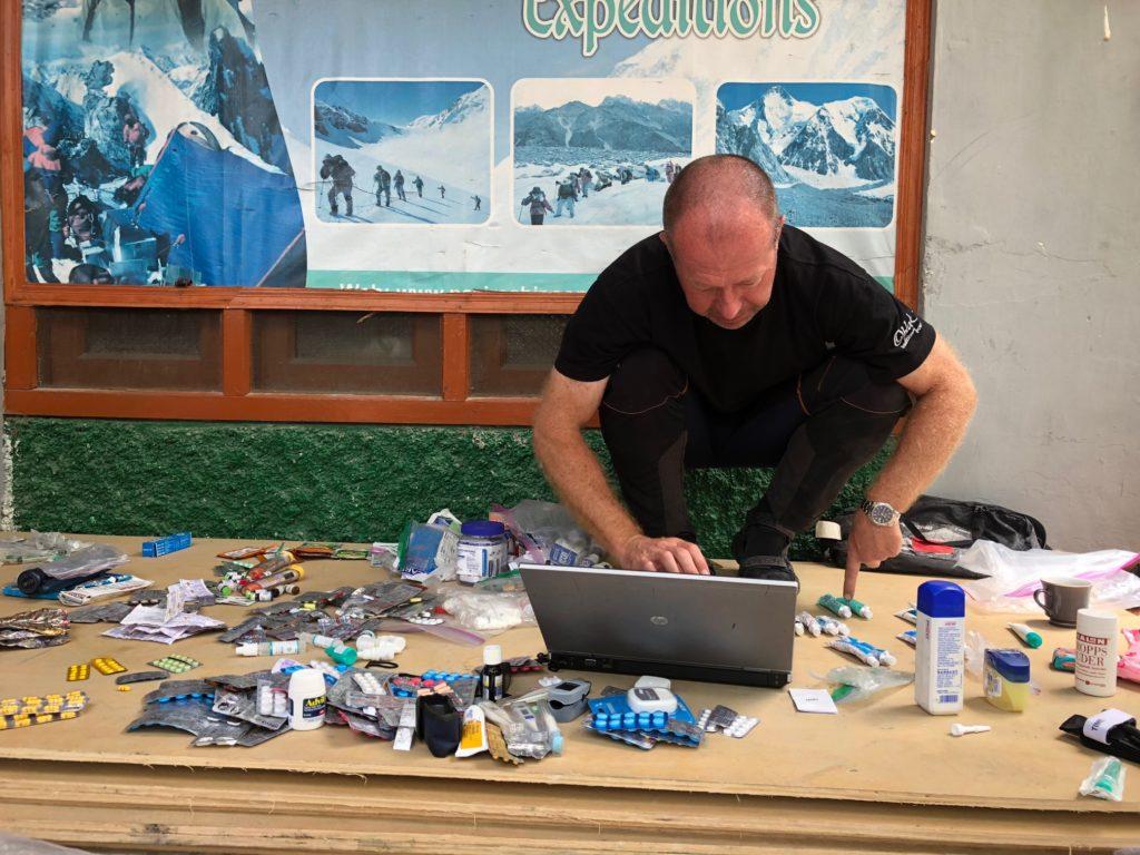Tomo sorting through the basecamp 1st aid kit