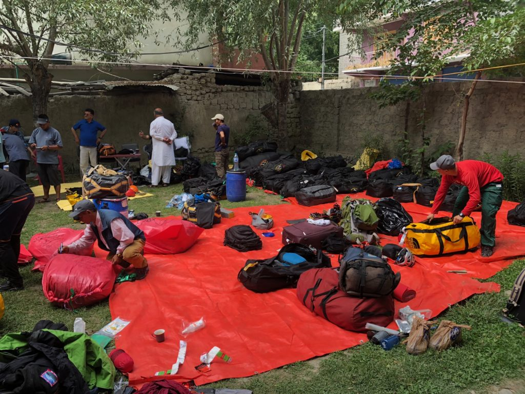 Sorting personal expedition equipment. Some bags go straight to BC, others accompany us on the walk in