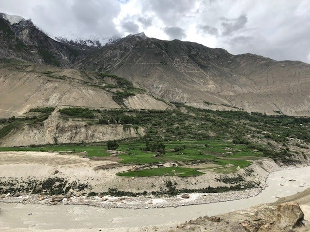 Lush green terraces on the otherwise arid banks of the river.