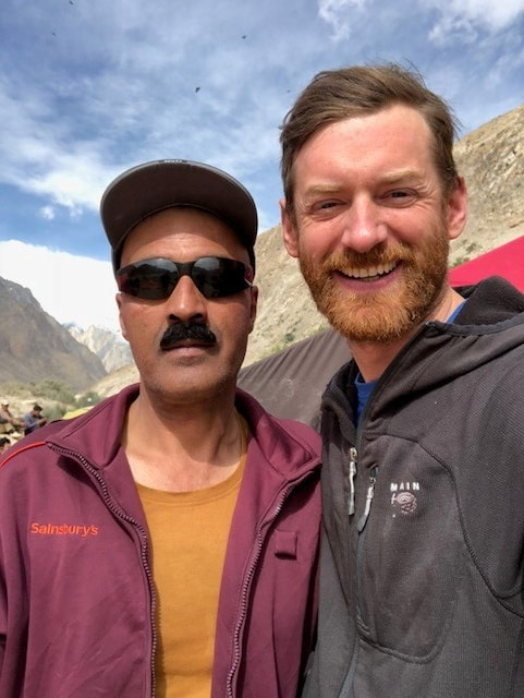 Jake and one of our trekking guides, Mr Naffice, wearing his favourite (Sainsbury's) jacket