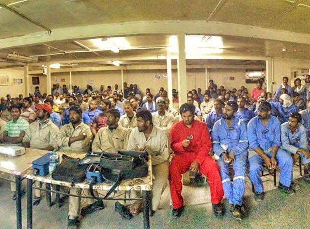 Photo of lots of workers sat down taking a survey